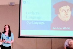 Iona, pictured at the beginning of a talk about Martin Luther's language.